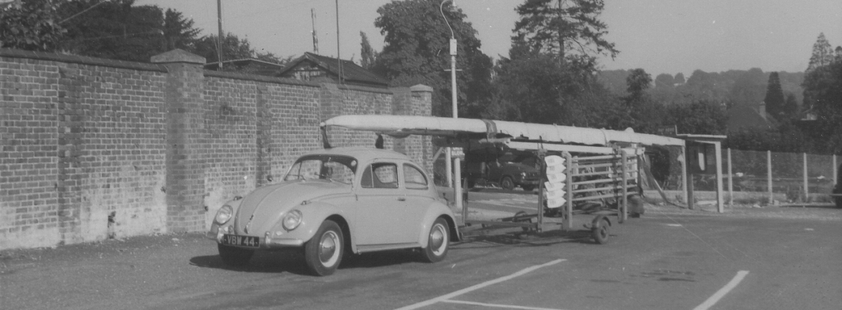 Beetle towing tiny trailer