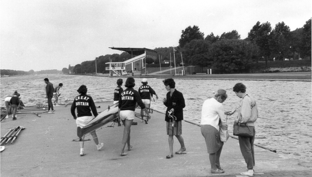 1964 UL coxed four carry boat to landing stage