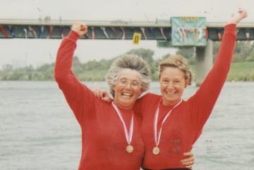 Women in red tops celebrate