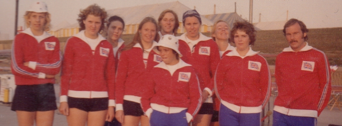 women in 1975 GB tracksuits with male coach