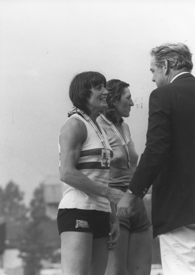 Beryl Mitchell being presented with her medal by Thomi Kepper