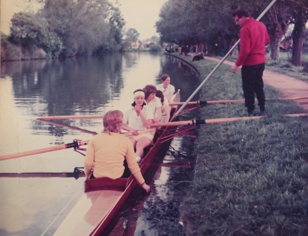 women's four being poled off