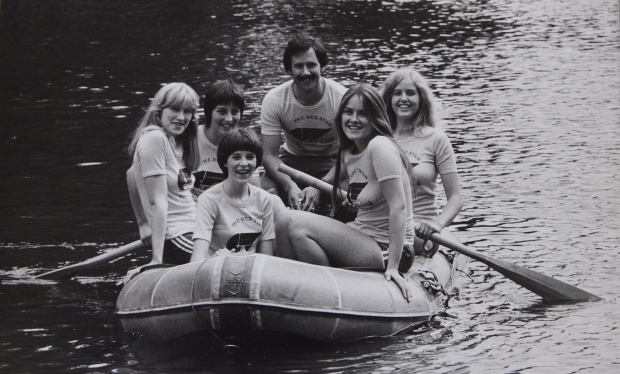 5 girls and their coach in an inflatable dinghy in CityLink t-shirts