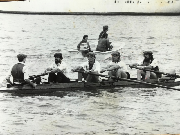 Coxed four in flat caps on the Tames