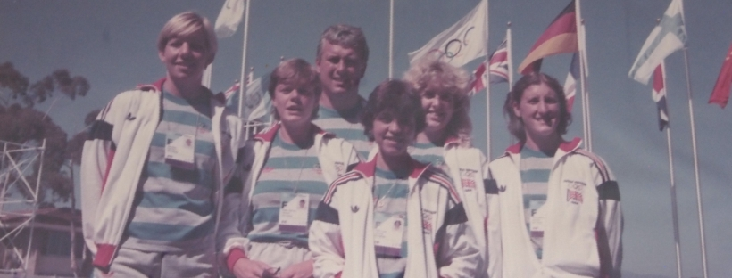 Crew and coach with flags behind