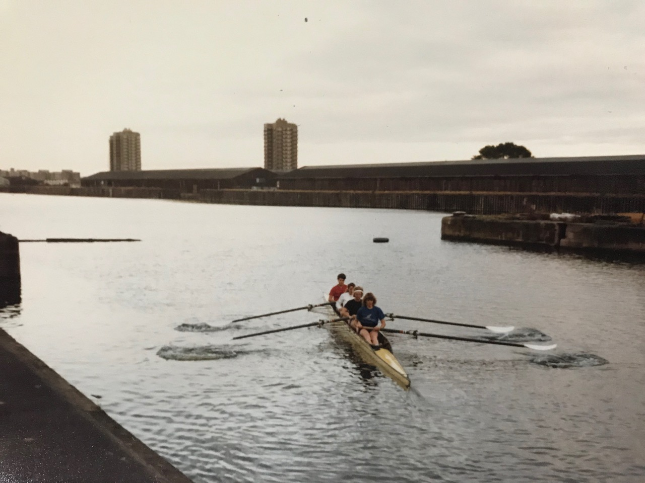 Rowing with warehouses in background