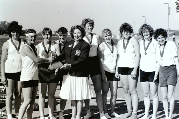 Eight with medals and trophy