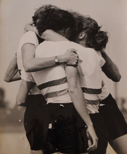 four women hugging after race