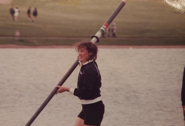 woman with oar on windy day