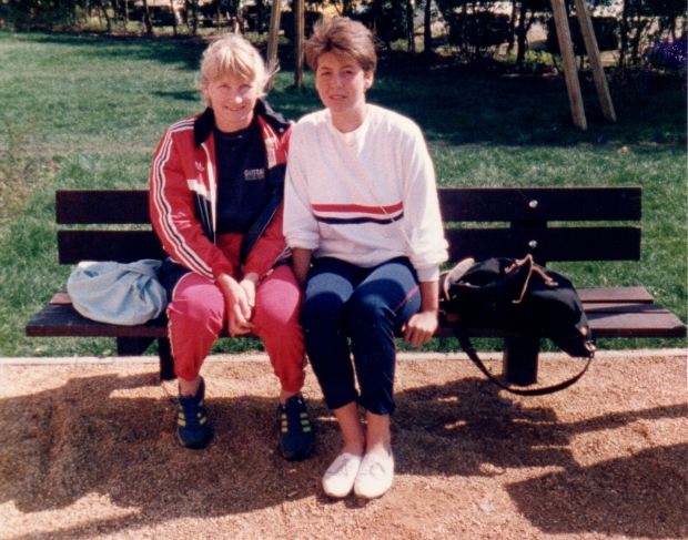 2 women in GB kit sitting on a bench