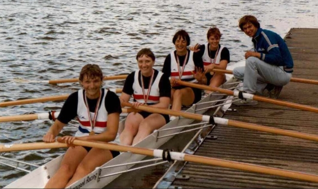 women in quad scull on raft