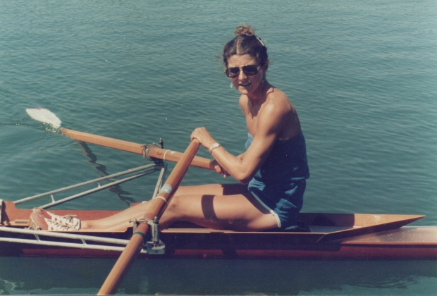 Woman in sculling boat in sunshine