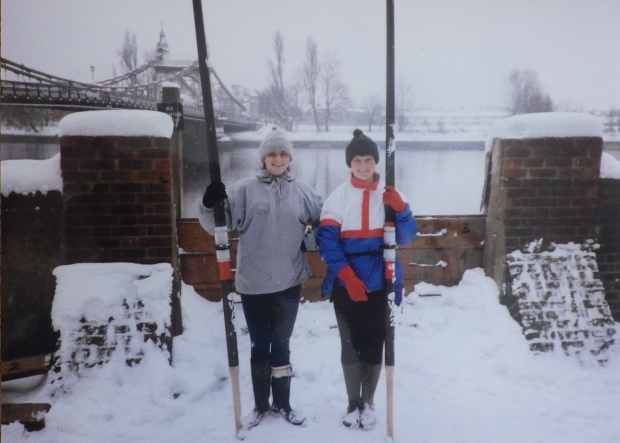 2 women with oars in snow