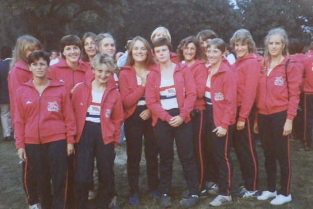 Women in red tracksuit tops