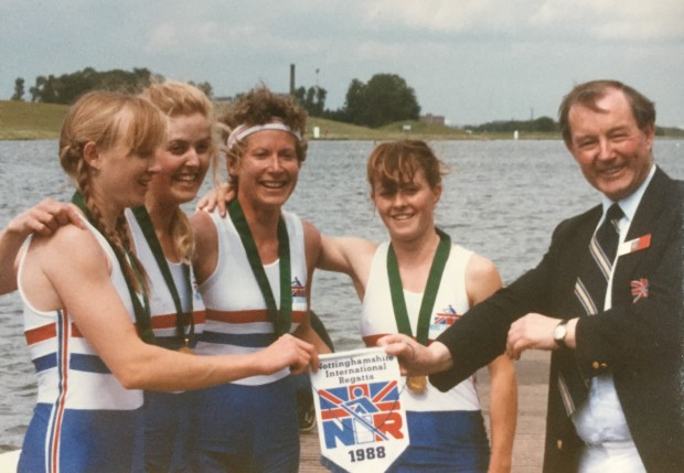 Four women with medals and pennant