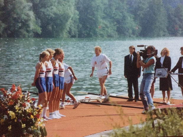 four women on pontoon being filmed by cameraman