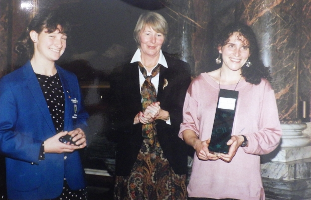 three women with awards