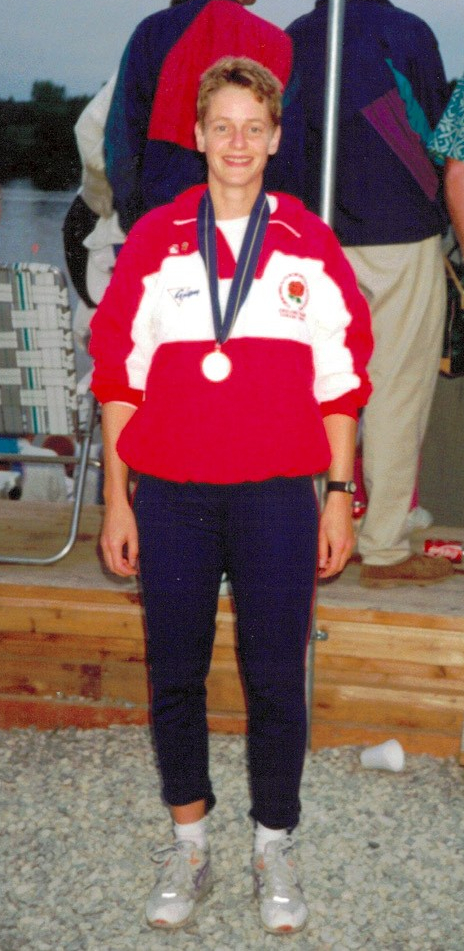 woman with medal in red and white England shirt
