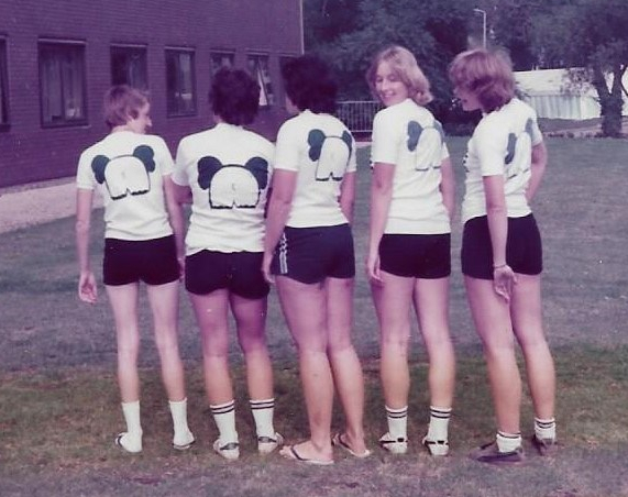 5 women with t-shirts showing elephant backside