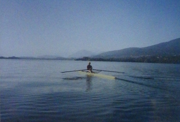 woman single sculler on flat water