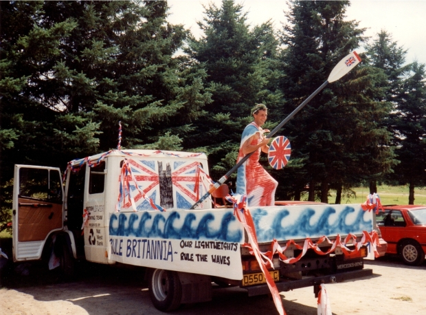 man dressed as Britannia with an oar