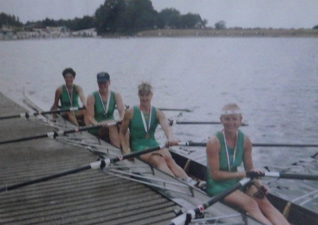 4 women in green lycra with gold medals