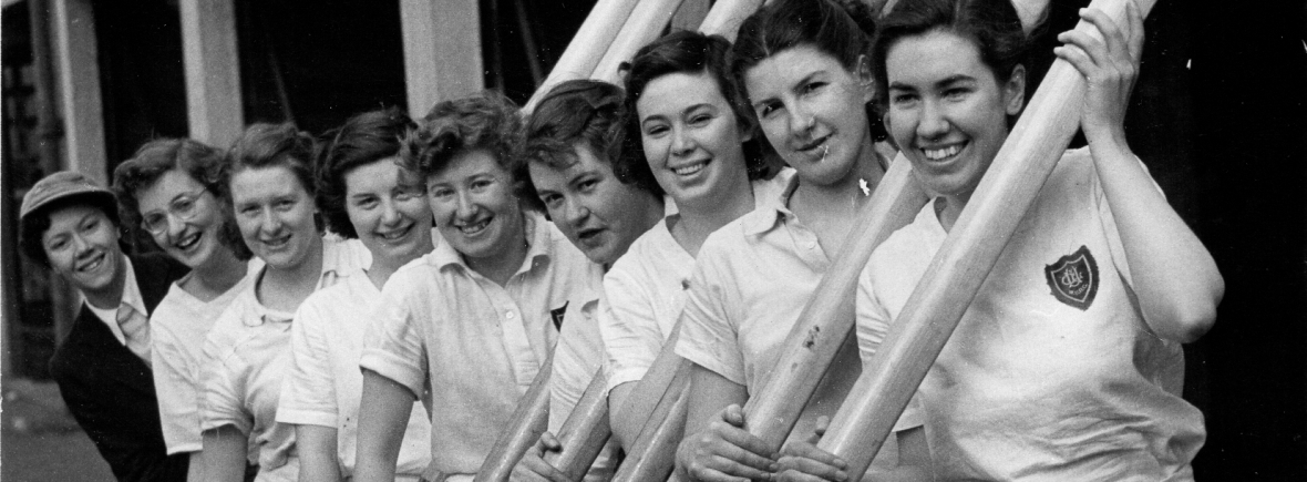 9 women in white shirts outside UL boathouse with oars @copy' Dailypress