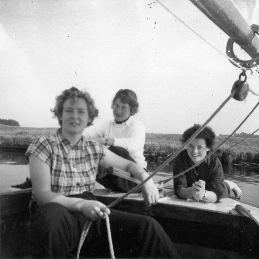 3 women in cockpit of small yacht