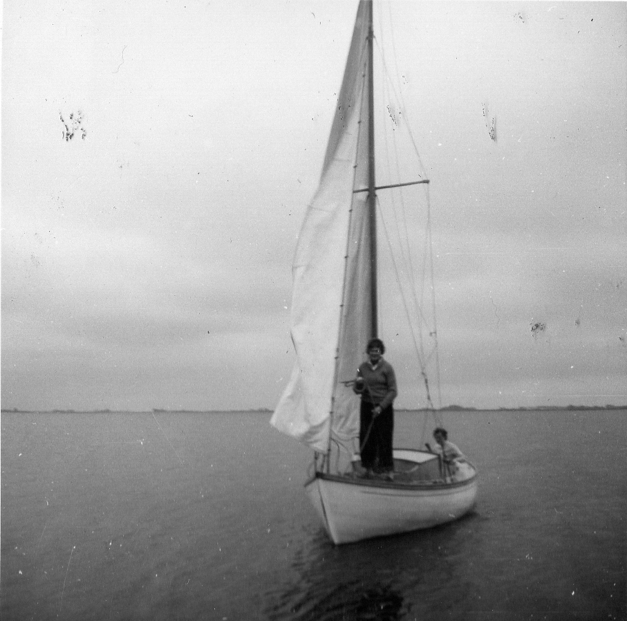 Two women on small cabin sailing yackt