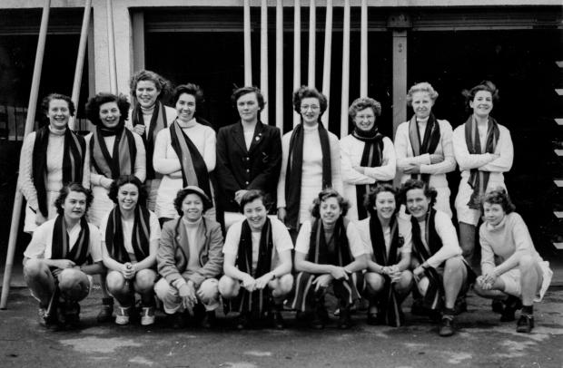 Women in college scarves and rowing kit
