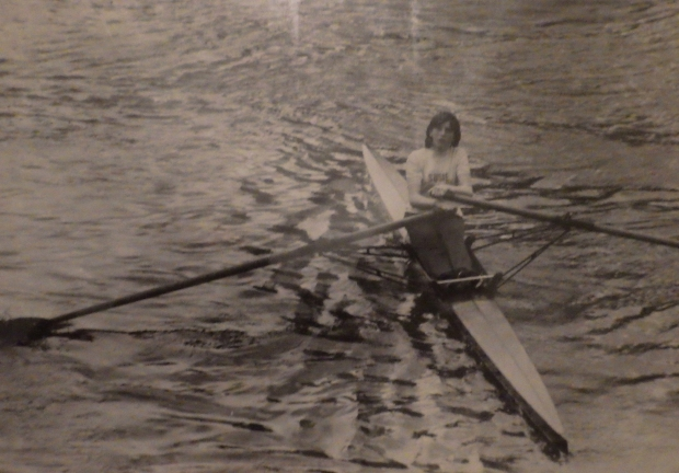 girl sculling - bw photo