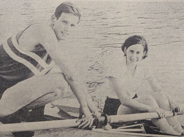 man and woman sculler