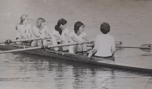 black and white photo of women's coxed four