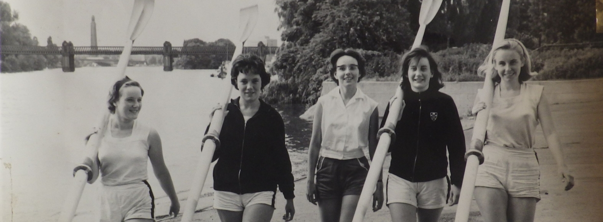 5 women carrying blades outside ULWBC with Kew Rail Bridge the background