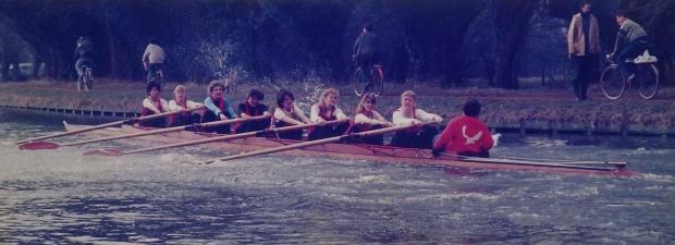 Women's eight in red vests