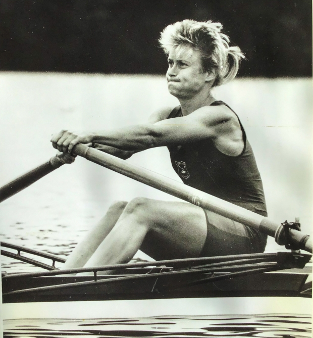 b/w photo of woman single sculler