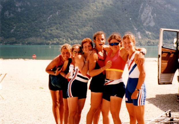 Women standig by lake in sun