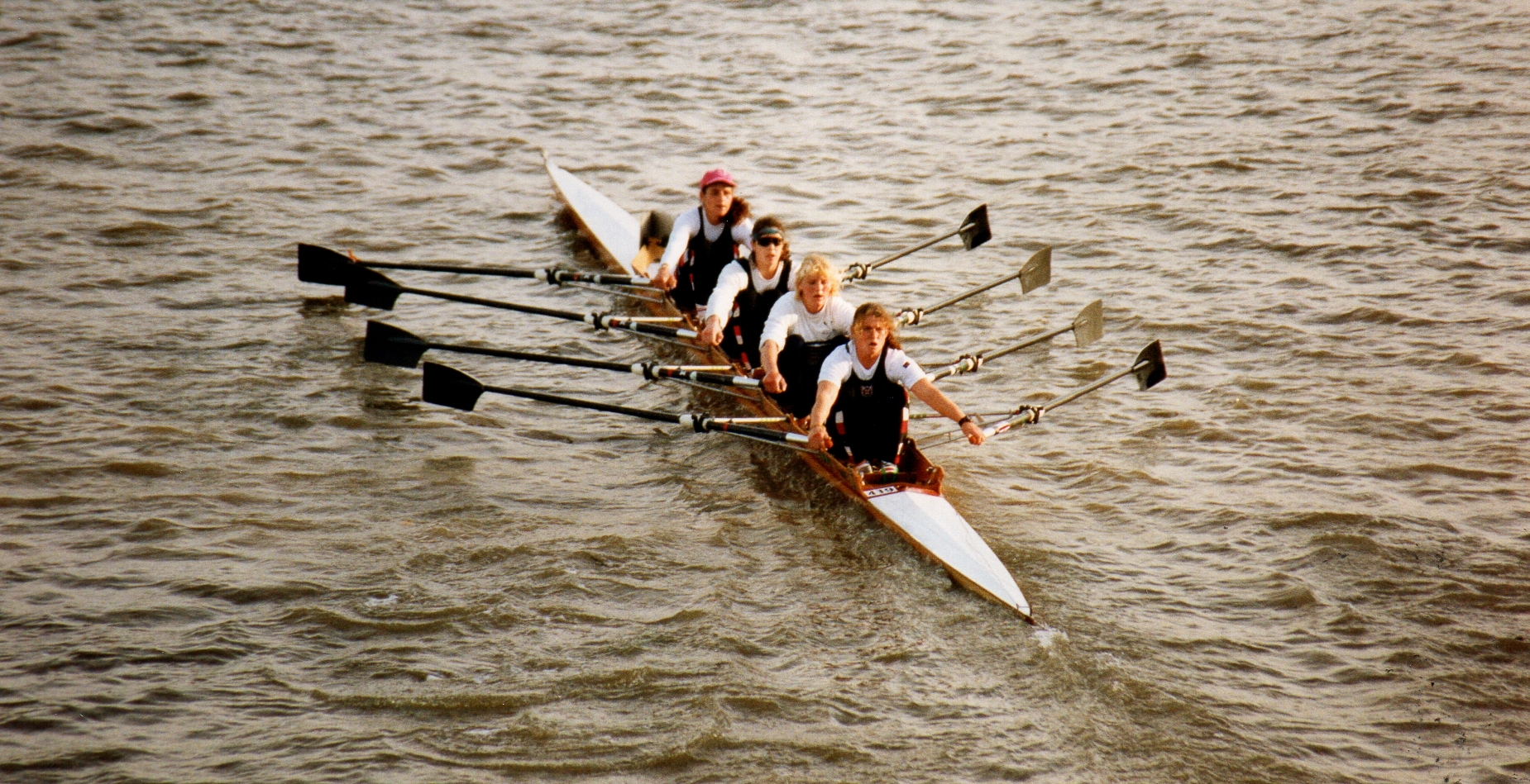 women's quad in wooden boat