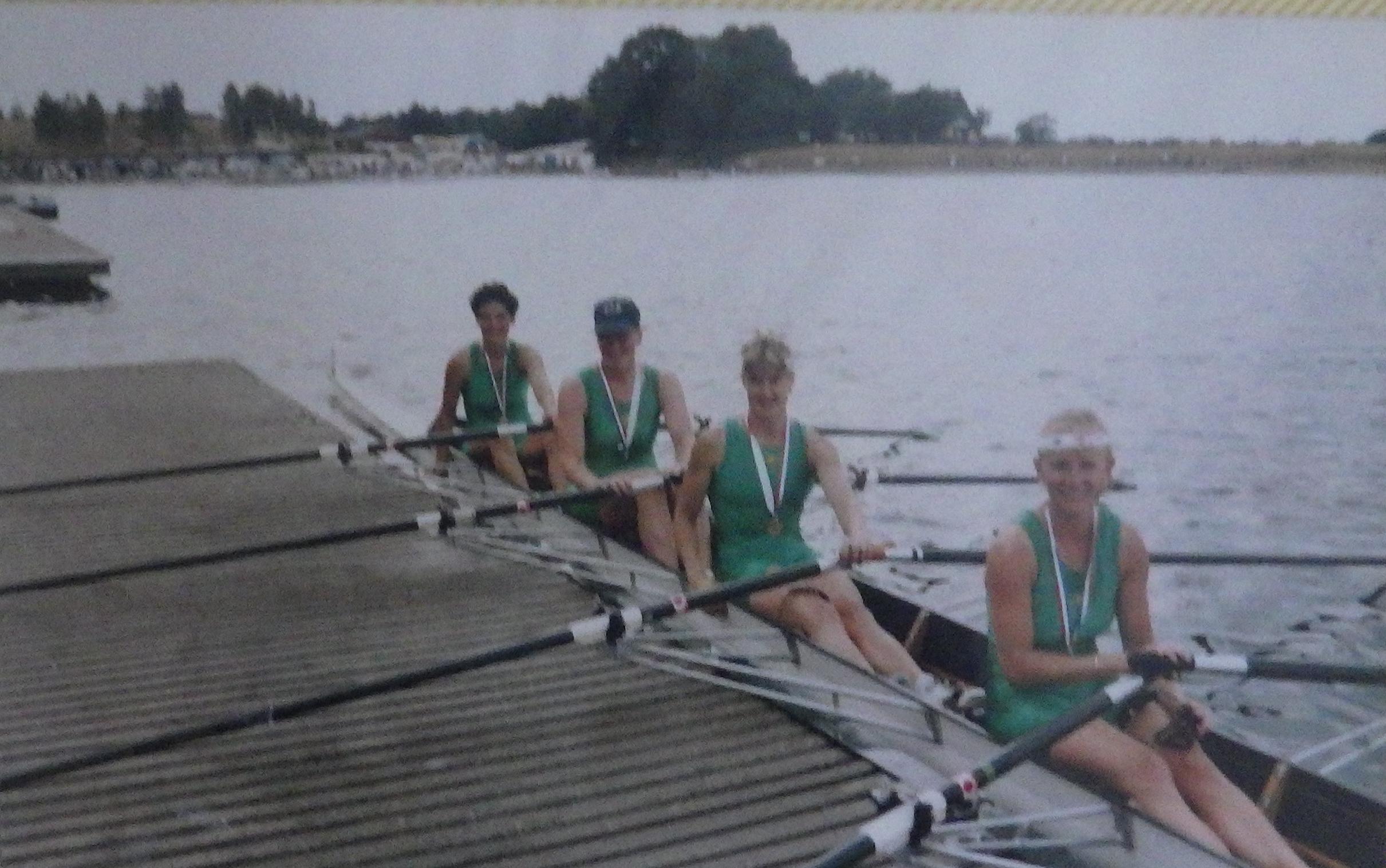 Women in NCRA green lycra on medal raft