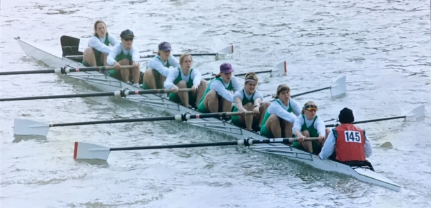 Women's eight in green lycra number 145 on cox