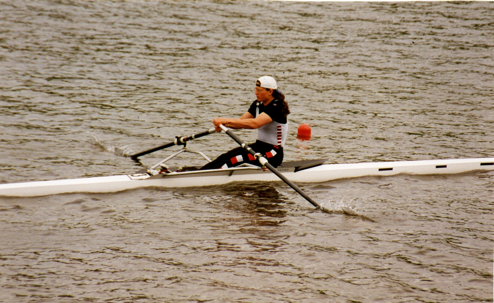 Woman sculler in Thames RC kit