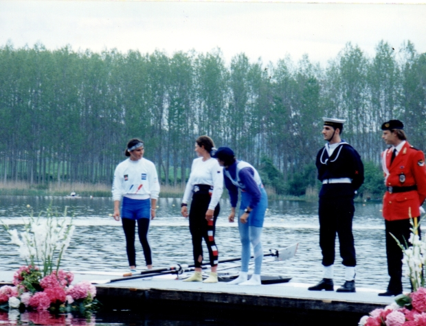 3 women scullers on raft