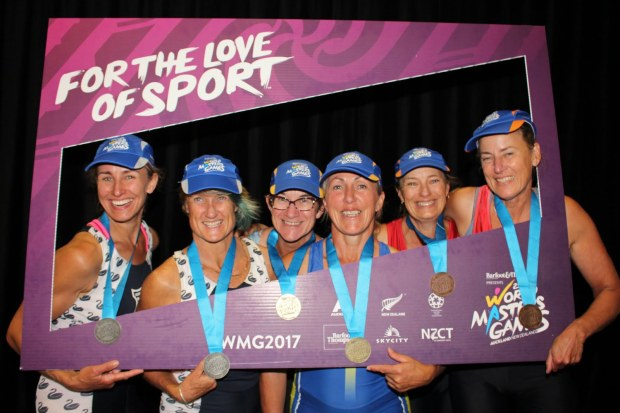 Veteran women rowers with medals