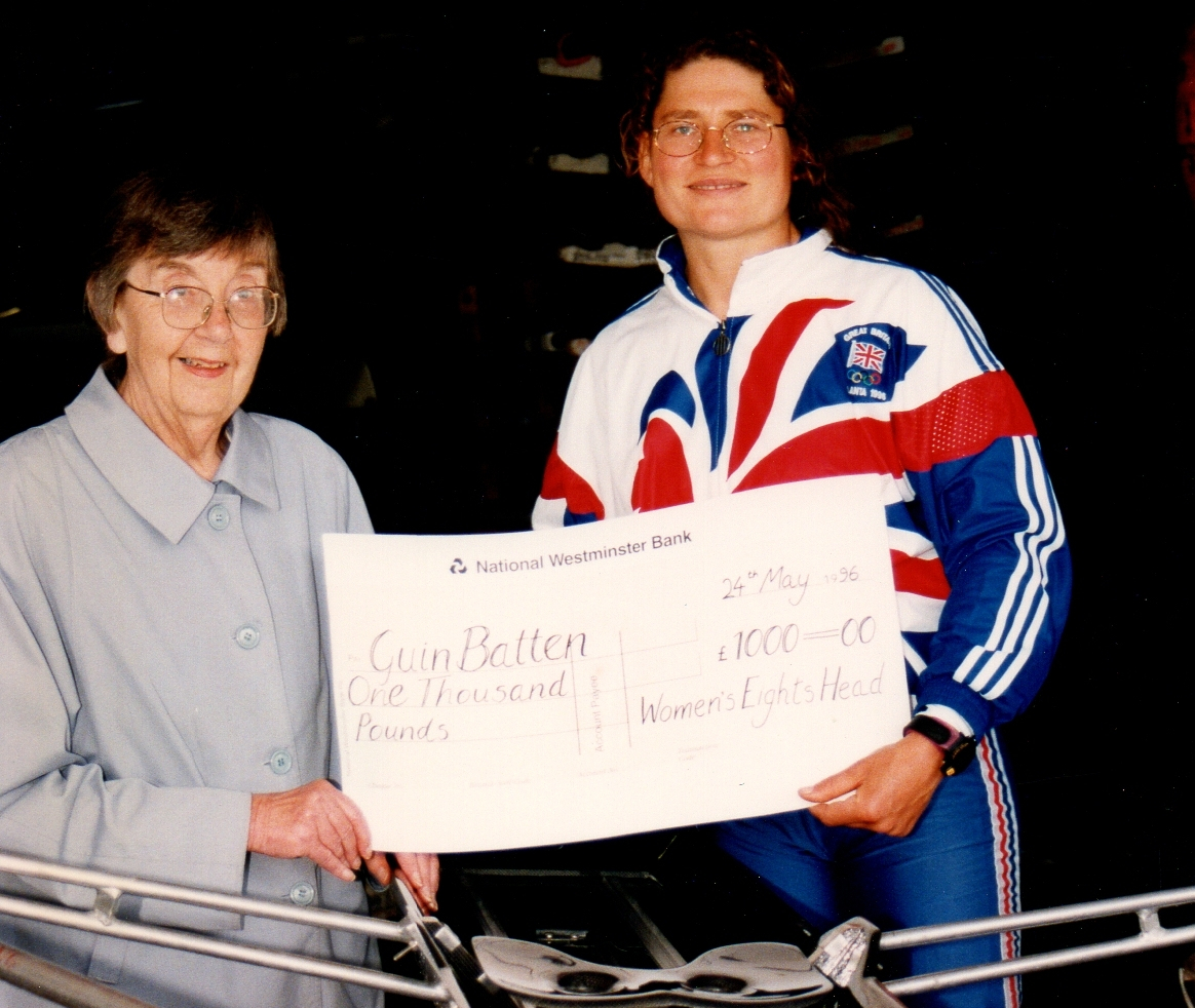 Older lady presenting cheque to athlete in GB kit