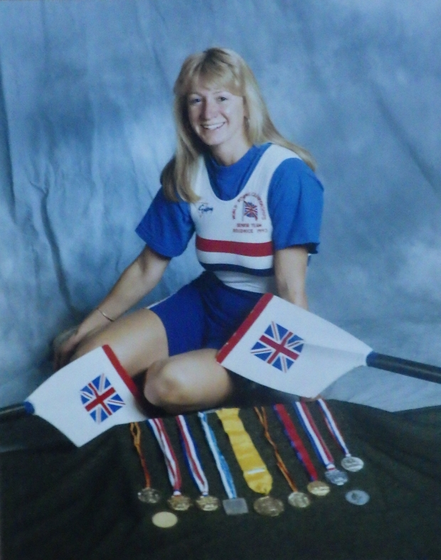 Woman in GB kit with blaes and medals