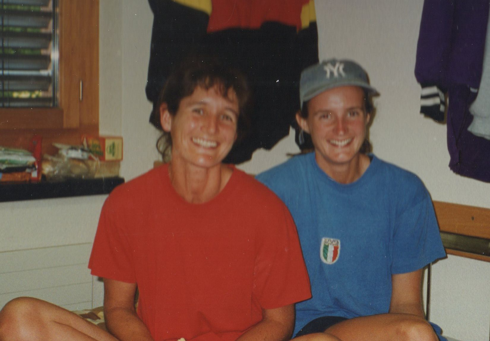 Two women in room full of rowing kit