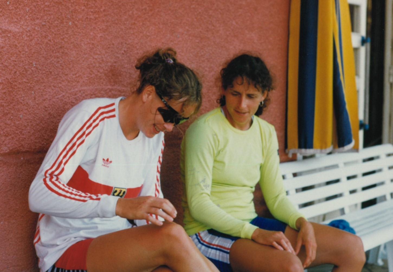 2 women relaxing on bench