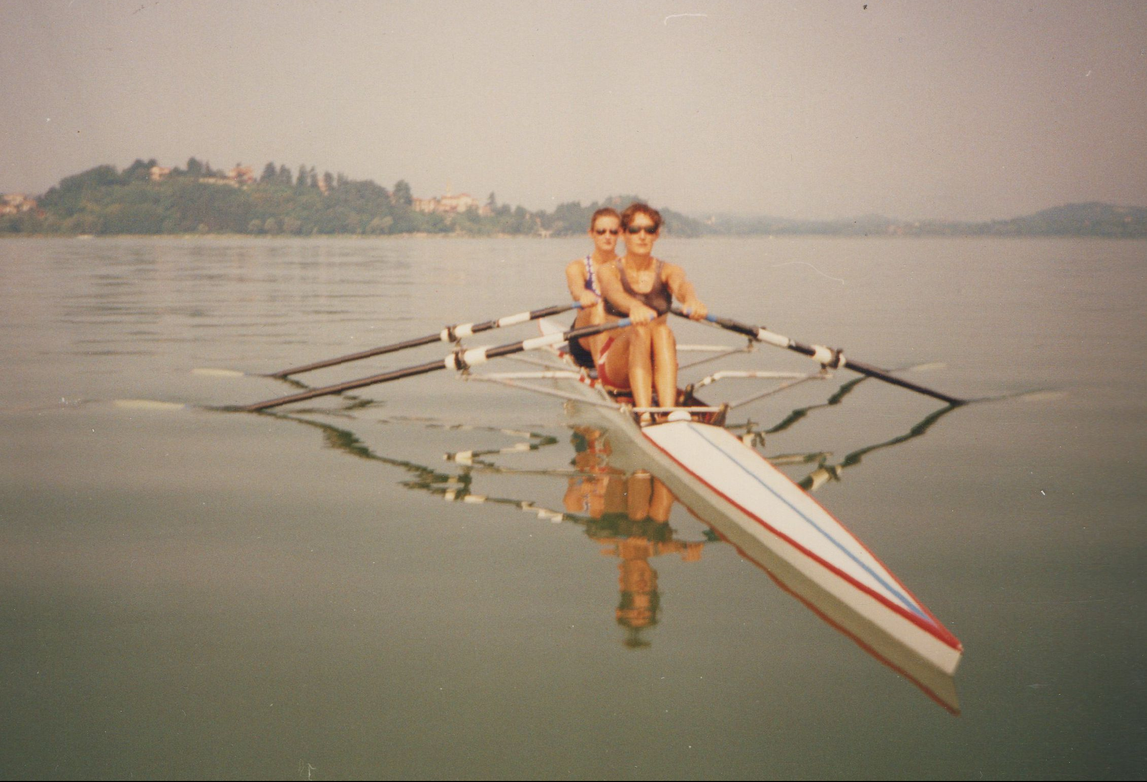 double scull on mirror-flat water