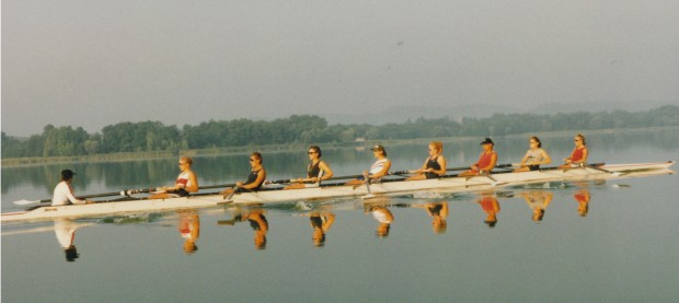 women' eight on mirror-flat water
