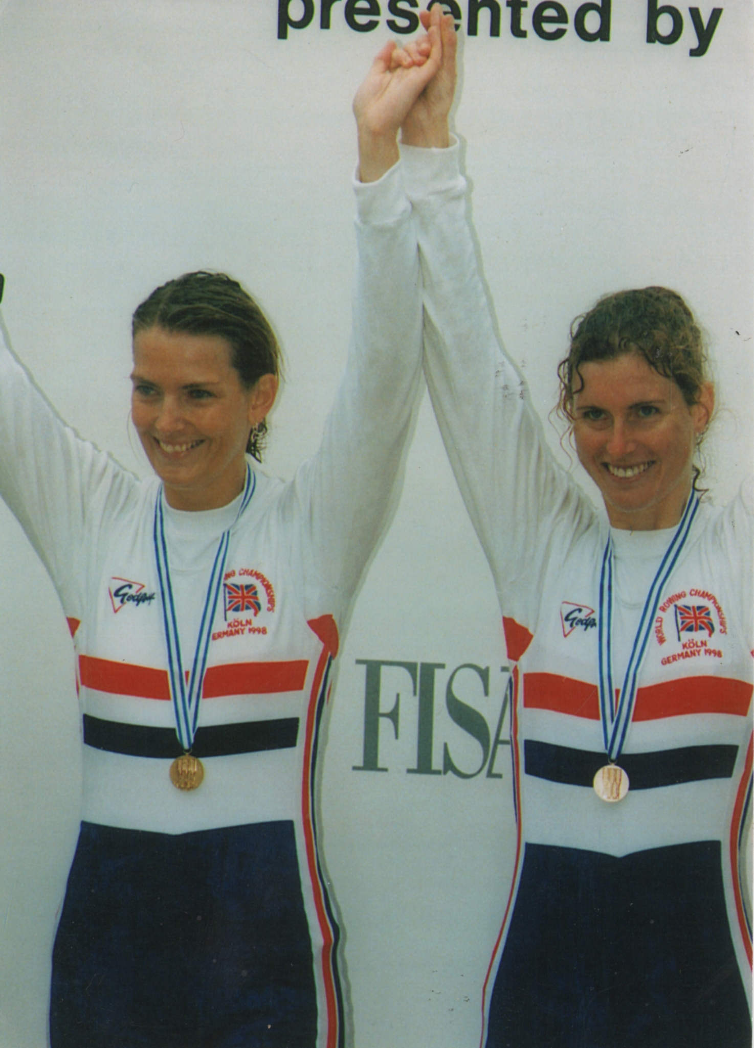 Two women with arms aloft
